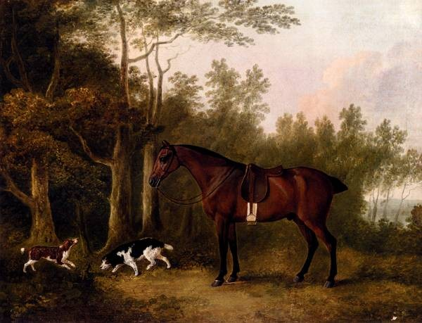 A Bay Hunter And Two Spaniels In A Landscape